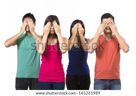 "Four Chinese people with their hands over their eyes. ""See no Evil"" concept. Isolated on white.  - stock photo"