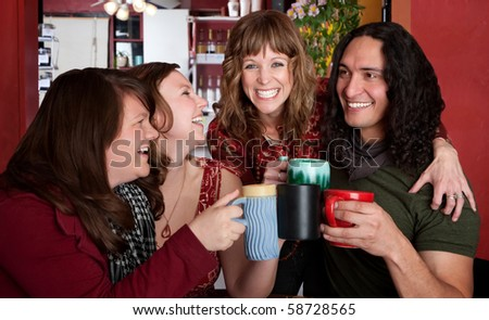 Four chummy friends hanging out at a bistro - stock photo