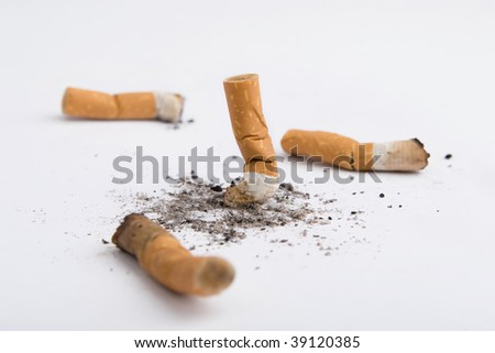 Four cigarettes butt isolated on white - stock photo