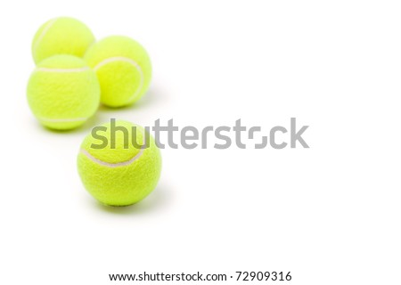 Four classic tennis balls isolated on white background - stock photo