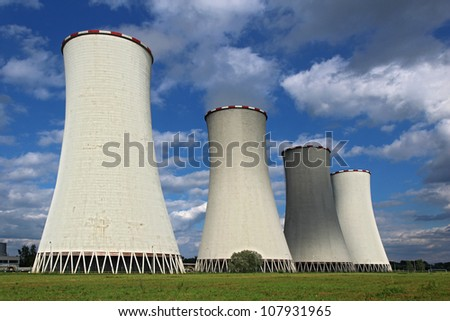four coal power plant cooling tower under dramatic sky