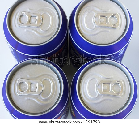 Four cold drinks cans against a white background - stock photo