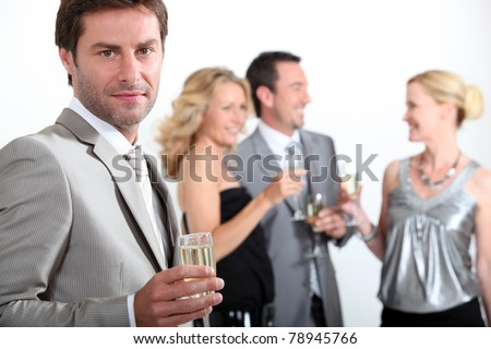 Four colleagues drinking champagne - stock photo
