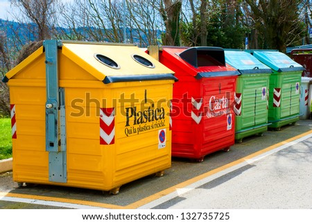 Four color trash cans (garbage bin) - stock photo