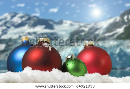 Four colored christmas balls in the snow - stock photo