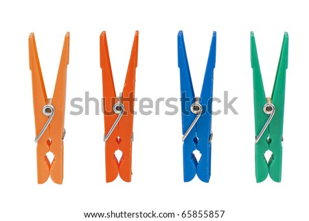 Four colored clothespin isolated on white background - stock photo