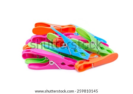 Four colored clothespin stack on white background - stock photo