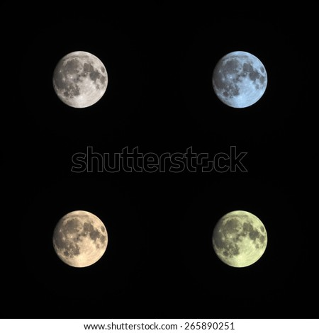 Four colored full moon isolated on black background - stock photo