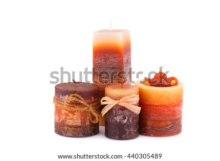 Four colorful candles isolated on white background.