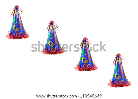 Four colorful celebration party hats in a diagonal line isolated on a white background with room for copy space. - stock photo