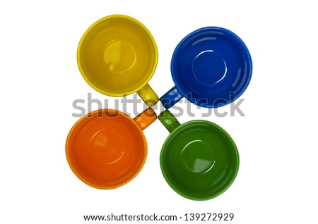 Four colorful cups, top view on white background