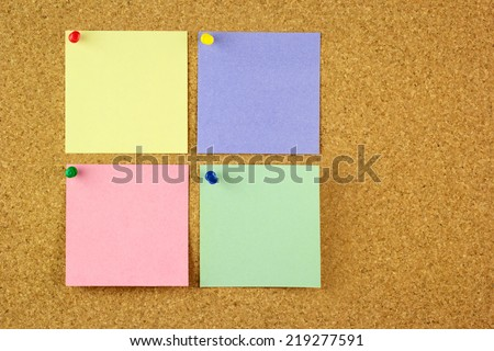 Four colorful different stickers pined on the corkboard \ horizontal - stock photo