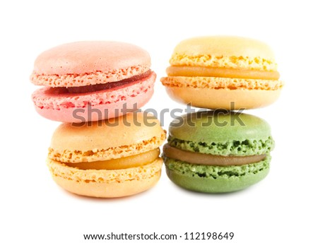 Four colorful french macaroons isolated on white background - stock photo