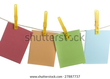four colorful notecards hanging on clothesline room for copy