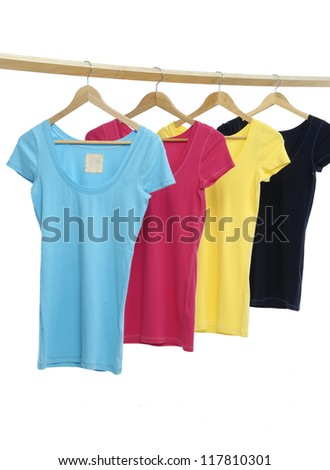 Four colorful on wooden hangers