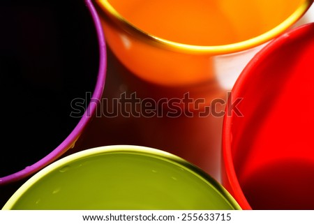 Four colorful plastic party cups. - stock photo