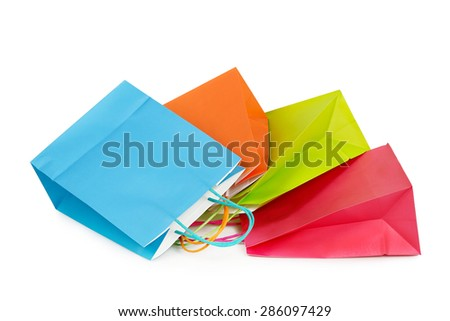 four colorful shopping bags closeup isolated on white - stock photo