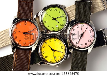 Four colorful watches - stock photo