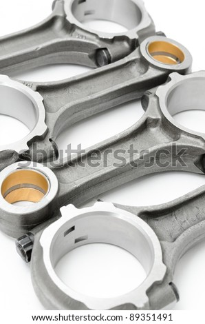 four connecting rods - spare parts of a disel engine - stock photo