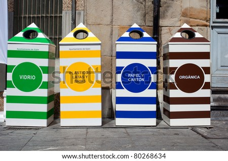 Four containers for recycling paper, metal, plastic and glass - Gijon, Asturias - stock photo
