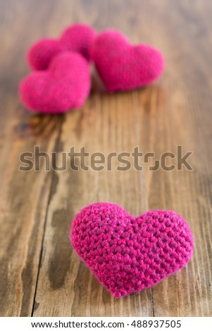 Four crocheted hearts