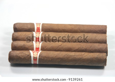 four cuban cigars in white background - stock photo