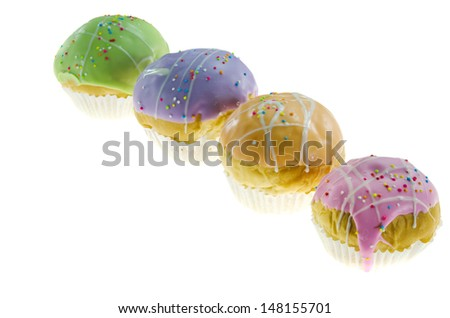 four  cupcake with colorful sprinkles on white background