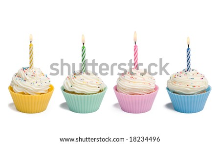 Four cupcakes with candle on white background - stock photo