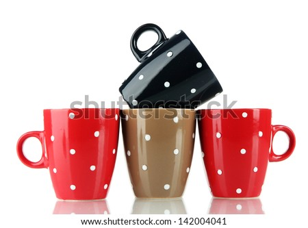 Four cups of polka dot isolated on white - stock photo