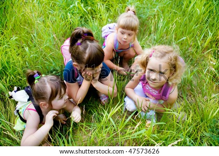 Four cute girls gossiping in a park - stock photo