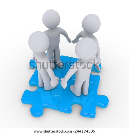 Four 3d people join on connected puzzle pieces