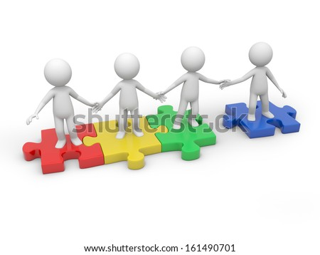 Four 3d people standing on four puzzle pieces