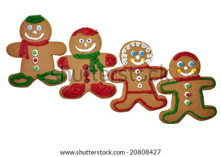 Four decorated gingerbread cookies isolated on white background with clipping path.
