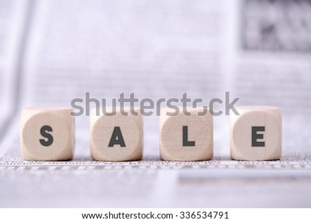 Four dice blocks with word sale written on. - stock photo