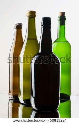 four different bottles on white background