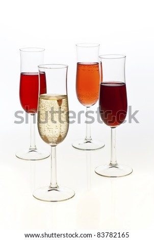 four different champagne in glasses isolated on white