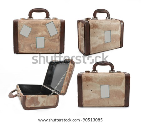 Four different isolated shots of an old rusty travel suitcase with stickers. - stock photo