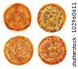 four different pizzas - stock photo