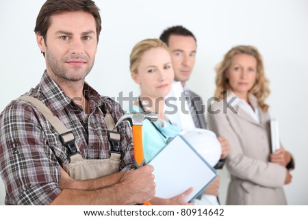 Four different professions with focus on carpenter - stock photo
