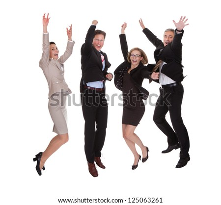 Four diverse professional business partners jumping for joy with their arms raised shouting in jubilation isolated on white