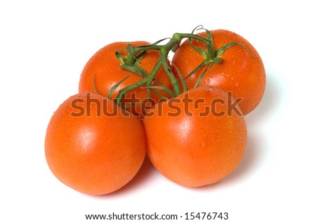 Four dropped tomatoes, isolated on white