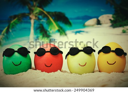 Four easter eggs with sunglasses on ocean beach � retro style - stock photo