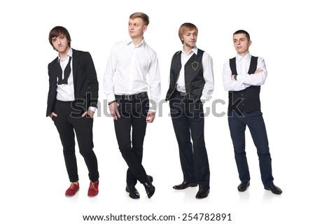Four elegant young men posing in full length over white background - stock photo