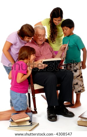 Four elementary kids and their grandpa enjoying some old photo albums together.  Isolated on white - stock photo