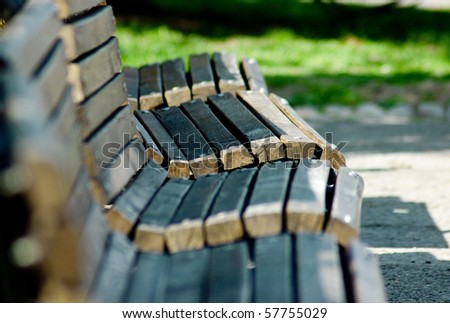 Four empty benches in the park. - stock photo