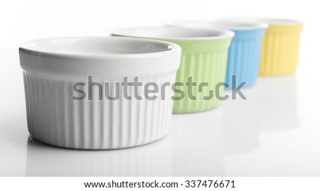 Four empty ceramic bowls, isolated on white - stock photo