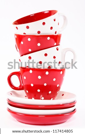 Four empty cup tower isolated on white - stock photo