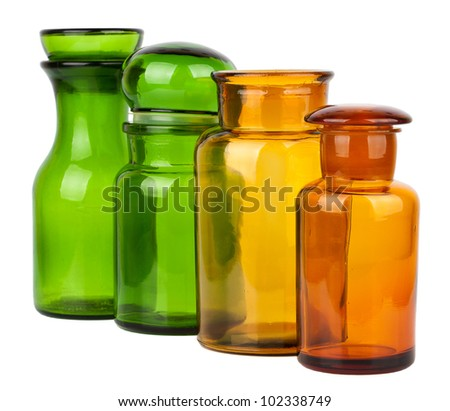 Four empty glass jars isolated on white background - stock photo