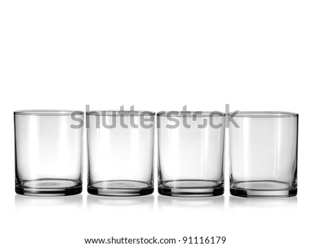 Four empty whiskey glasses