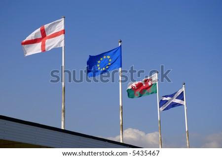 four European/British flags against clear summer sky - stock photo